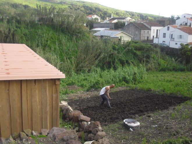 Starting a new garden, side view of our little cottage, the baby napping, and Joao getting the soil ready